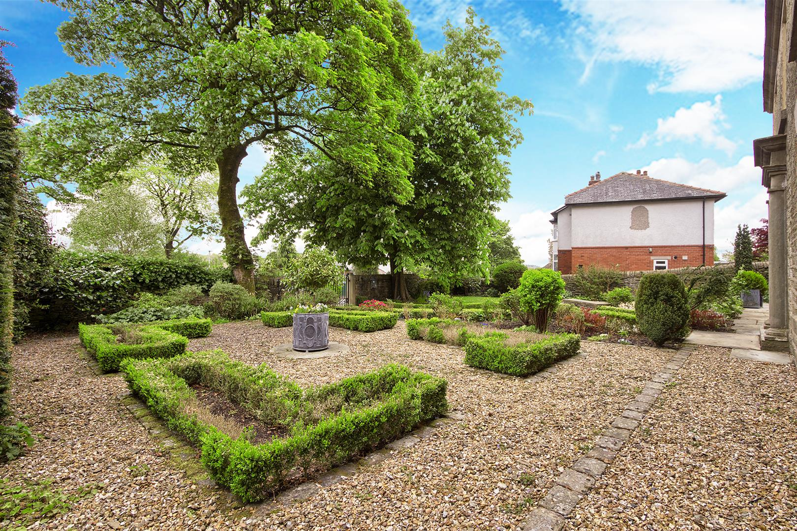 5 bedroom detached house For Sale in Bolton - front garden 2.png.
